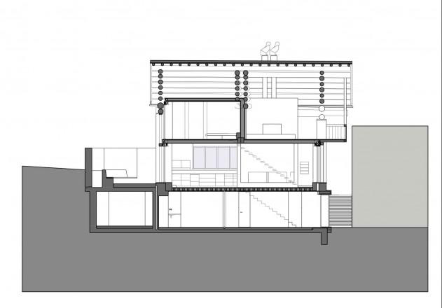 Ruinelli Associati Architetti wohnen im Stall Laengsschnitt
