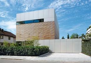 Lynx Architecture weniger ist mehr Modernes Einfamilienhaus 3 Etagen Zwischengeschoss Holz Garage
