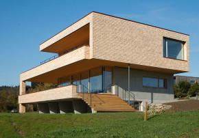 k_m architektur umweltbewusst Bauen Massivbau Schindelverkleidung