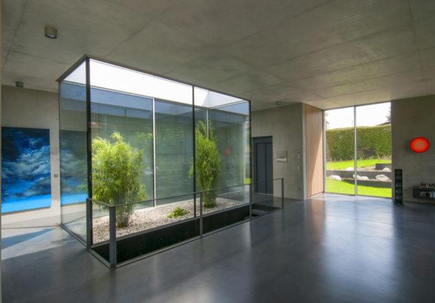 Architekturbüro di Simone Architektin Einfamilienhaus Starnbergersee  verglastes Atrium