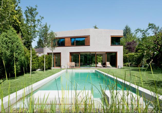 Lynx Architecture Einfamilienhaus gestockter Beton Gartenfassade Pool