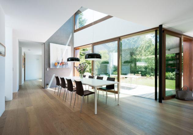 Lynx Architecture Einfamilienhaus gestockter Beton Innenansicht Essbereich Terrasse