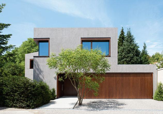 Lynx Architecture Einfamilienhaus gestockter Beton Strassenfassade