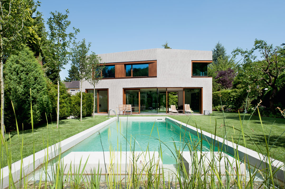 Lynx Architecture Einfamilienhaus gestockter Beton Gartenfassade Pool